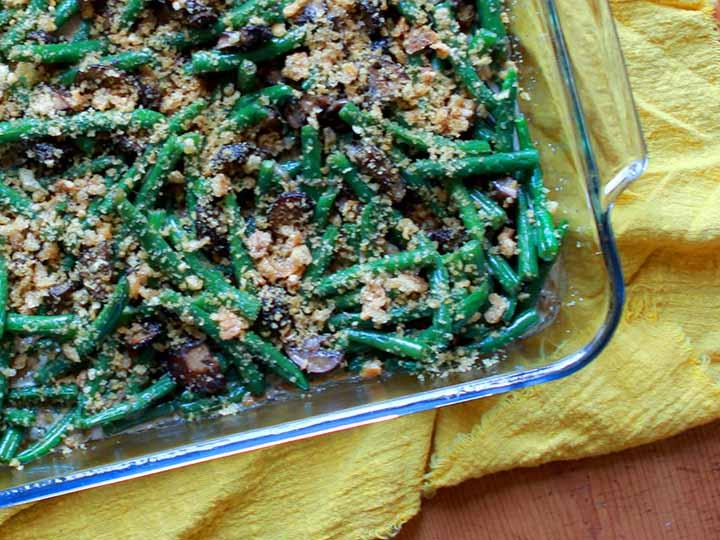 A pan of gluten free grain free green bean casserole against a yellow cloth napkin