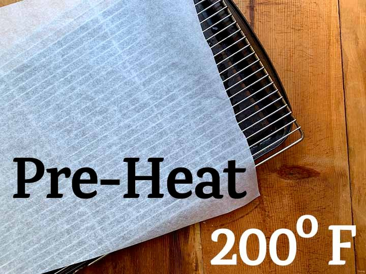 step 1 Pre-Heat over to 200 degrees F and cover a cooling rack with parchment paper