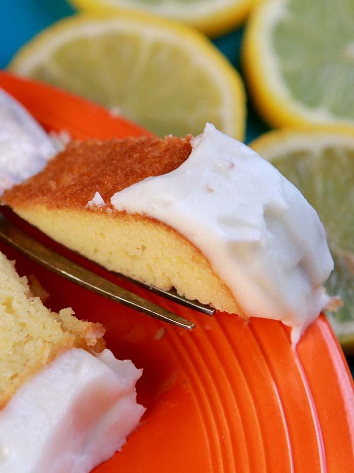 a fork holds a bite of sugar free lemon pound cake
