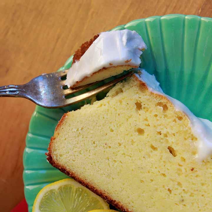 a fork cutting into a piece of sugar free lemon pound cake