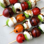a tray of Keto Caprese Salad on SKewers