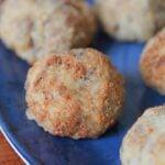 close up view of Keto sauerkraut sausage balls on a blue plate
