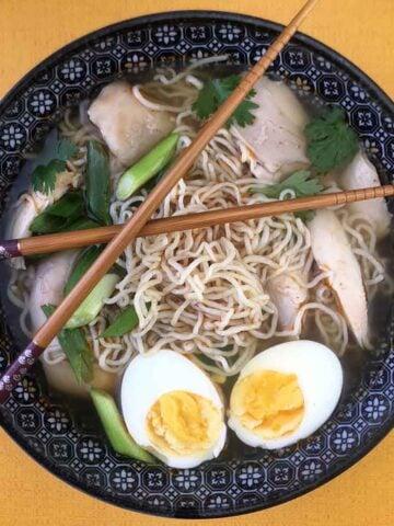 a bowl of Keto Chicken Ramen Soup with Shirataki Noodles