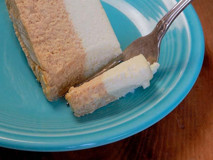 A fork picks up a bit of low carb pumpkin cheesecake