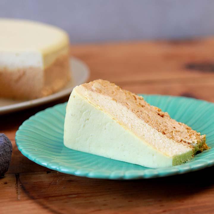 a slice of sugar-free pumpkin cheesecake on a green plate