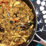 a wok filled with Chicken and Eggplant Biryani