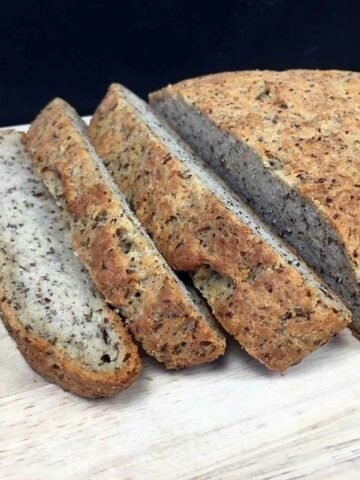 a sliced loaf of Keto Rustic Yeast Bread