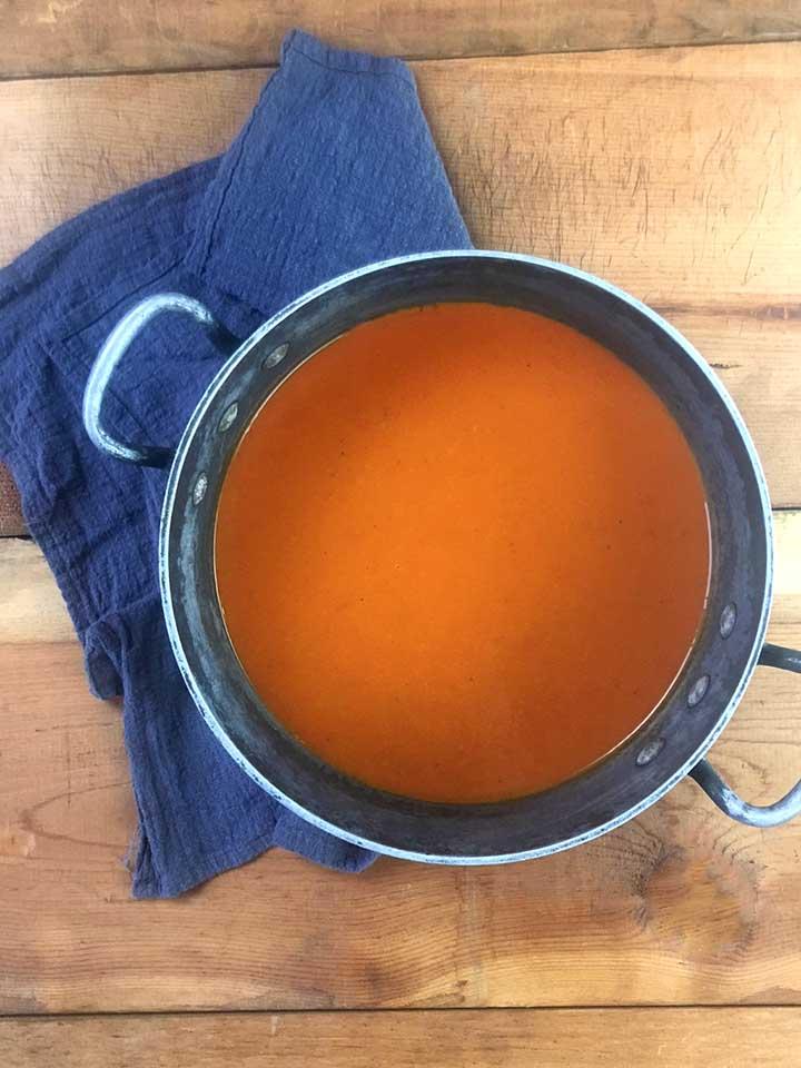 a top down view of a soup pot holding sugar-free tomato soup
