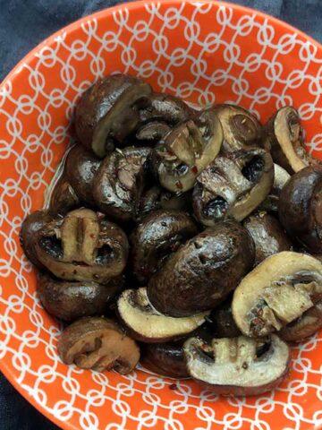 a bowl of Keto Marinated Mushrooms