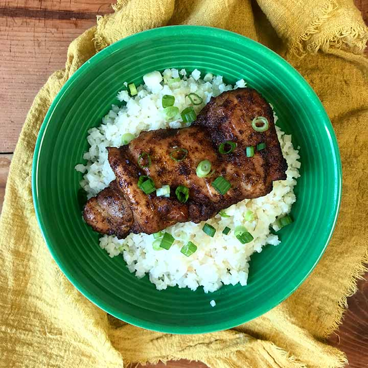 the best chili lime chicken thigh on a green plate