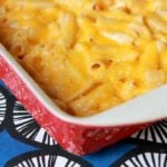 red casserole dish holding low carb keto mac and cheese