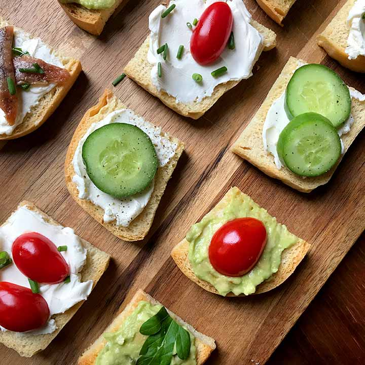 Top down shot of a cutting board with low carb melba toast appetizers