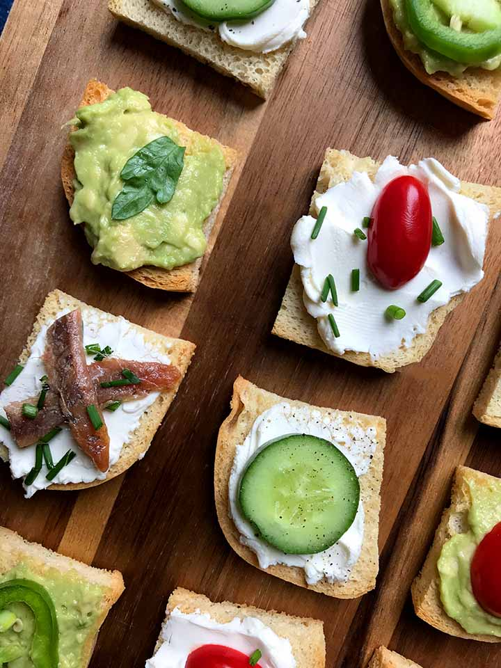 Melba Toast Hors d'oeuvre with cucumber tomato anchovies