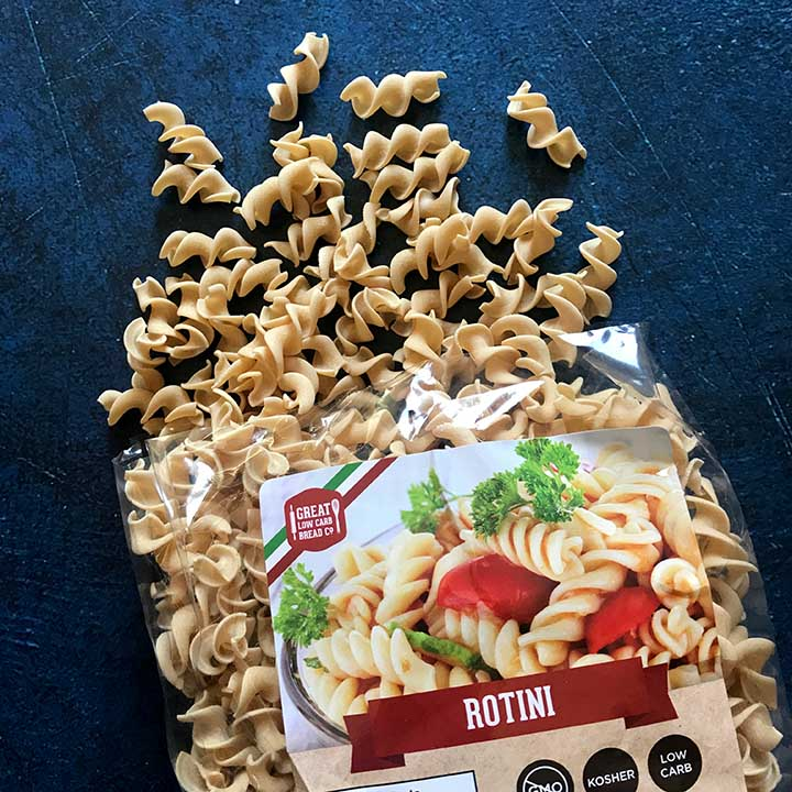 Bag of Great Low Carb Baking Co. rotini noodles with noodles falling out