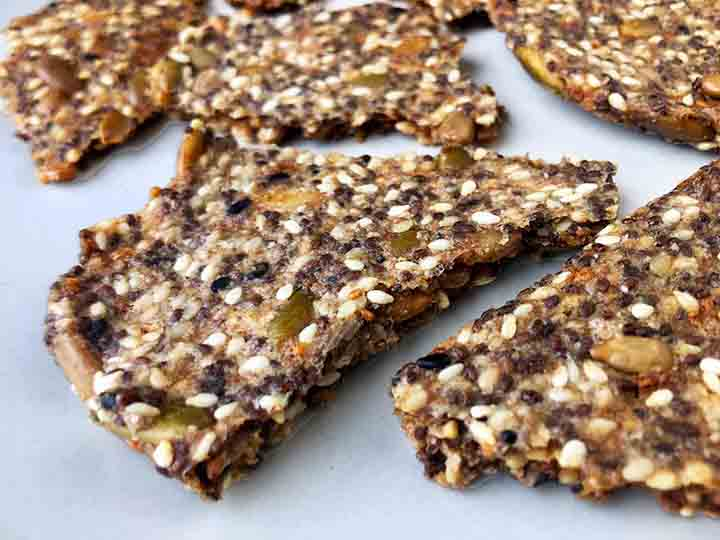 Close Up Photo of sesame seed crackers with flax seed and pysllium powder