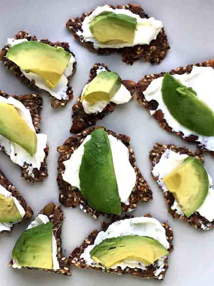 Close Up image of Low Carb Seed Crackers with cream cheese and avocado