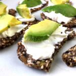 Flax Seed Crackers with cream cheese and avocado