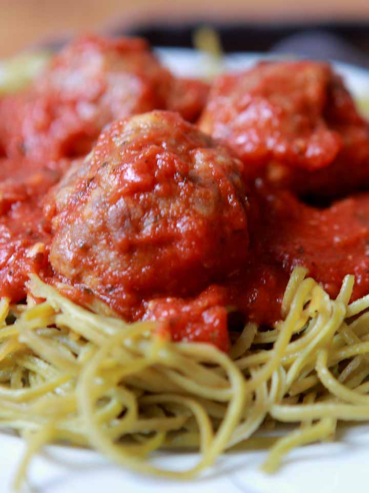 a close up image of low carb spaghetti and meatballs