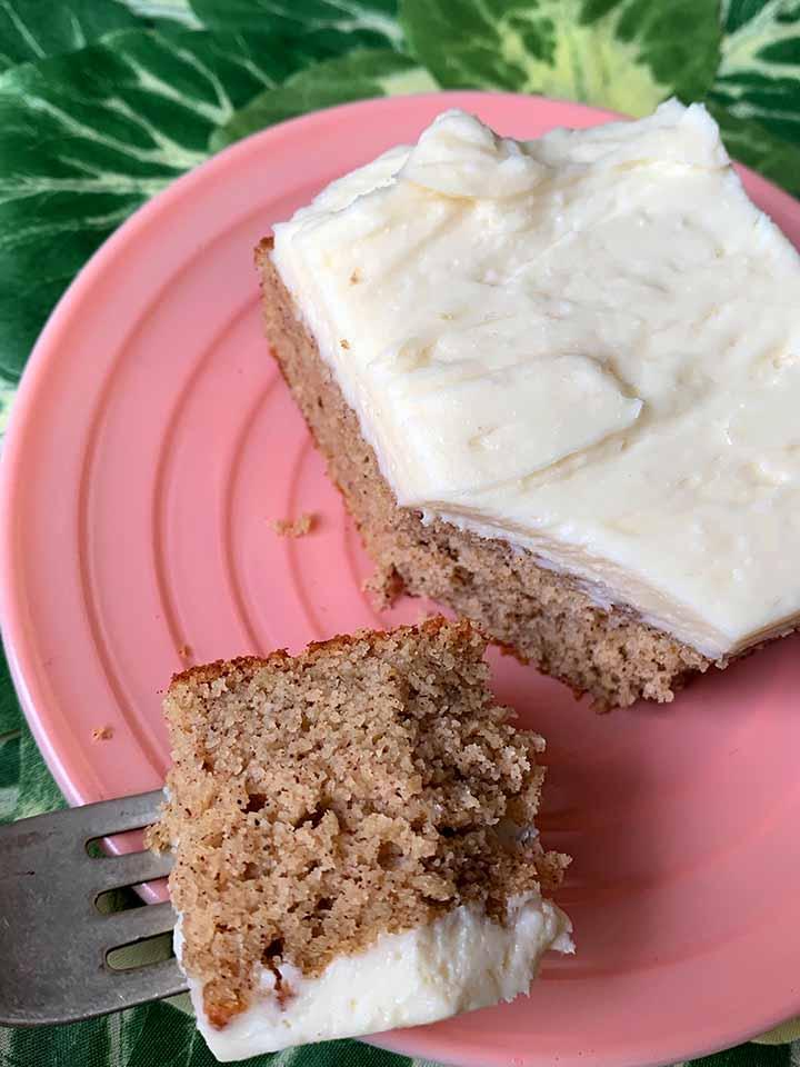 a fork holds a bite of Keto spice cake