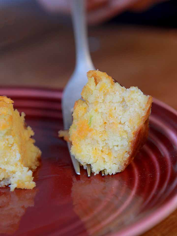 a fork hold a bite of low carb jalapeno cornbread