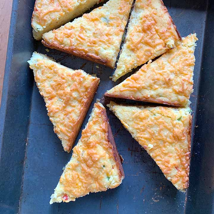 a top down view of 6 slices of gluten free jalapeno cornbread