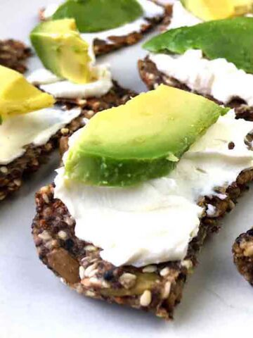 Keto Seed Crackers topped with Cream Cheese and Avocado
