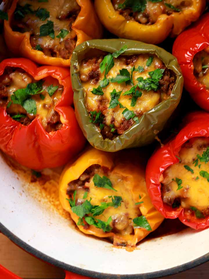 a dutch oven filled with low carb stuffed bell peppers
