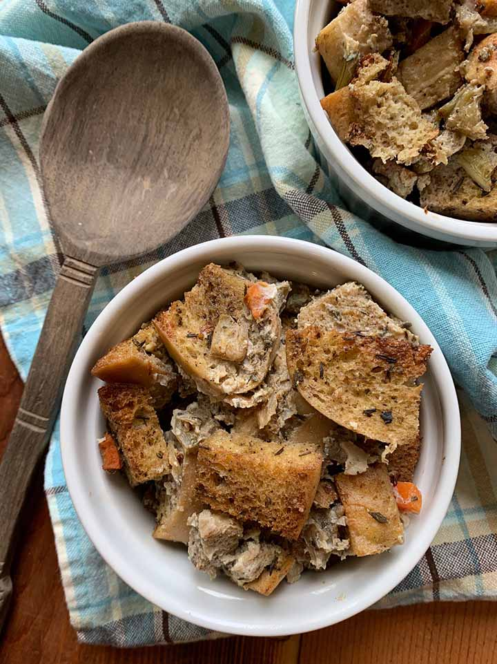 a top down view of two bowls of zero net carb bread stuffing