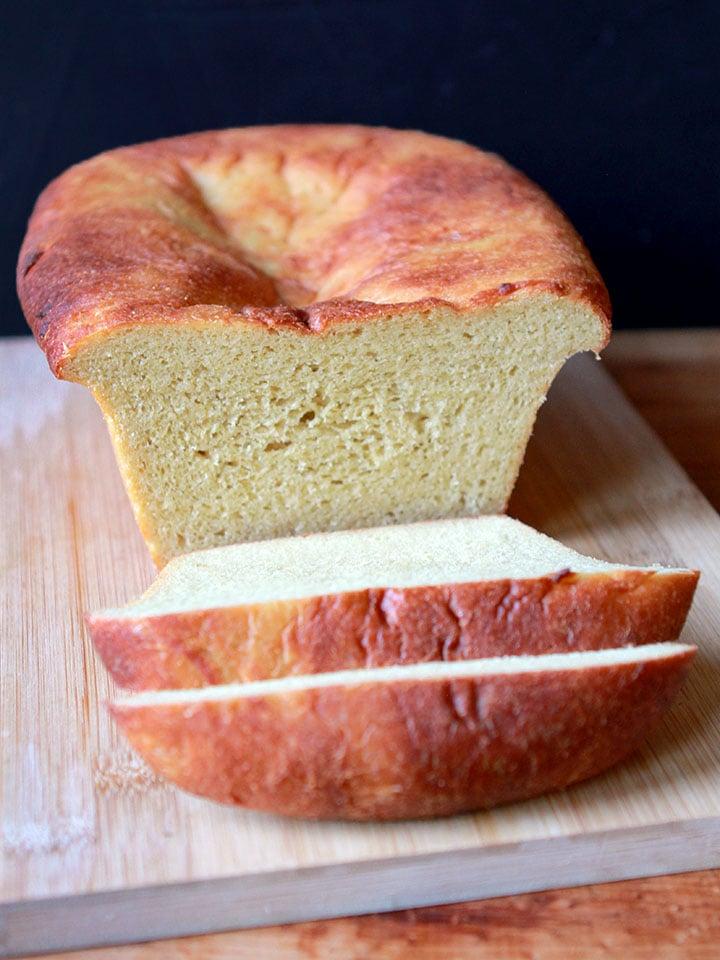 a sliced loaf of Keto yeast bread on a cutting board