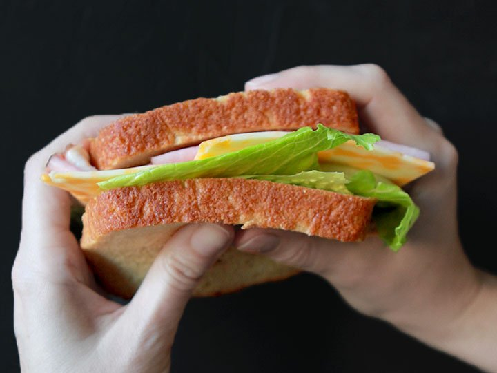 two hands hold a low carb sandwich