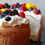 a low carb angel food cake with a piece sliced out
