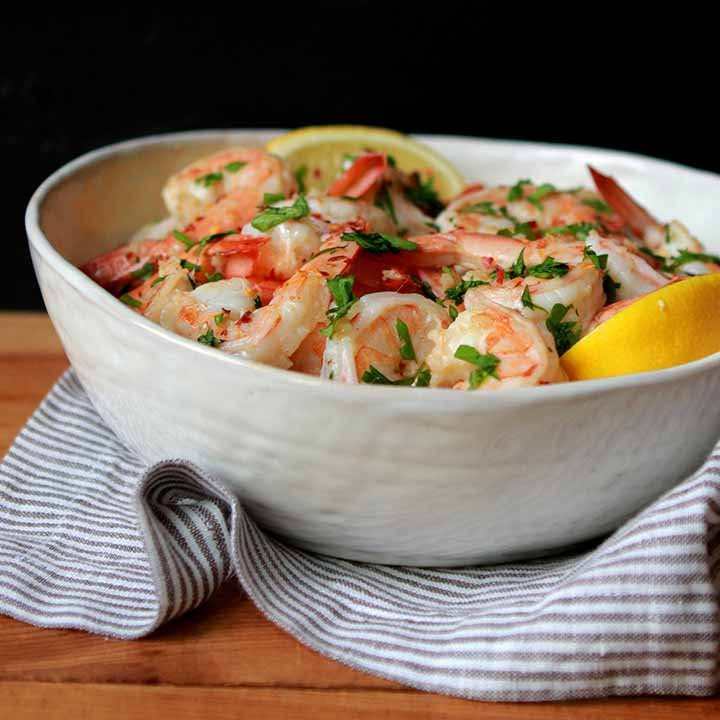 a white bowl filled with Keto Shrimp Scamp against a black background