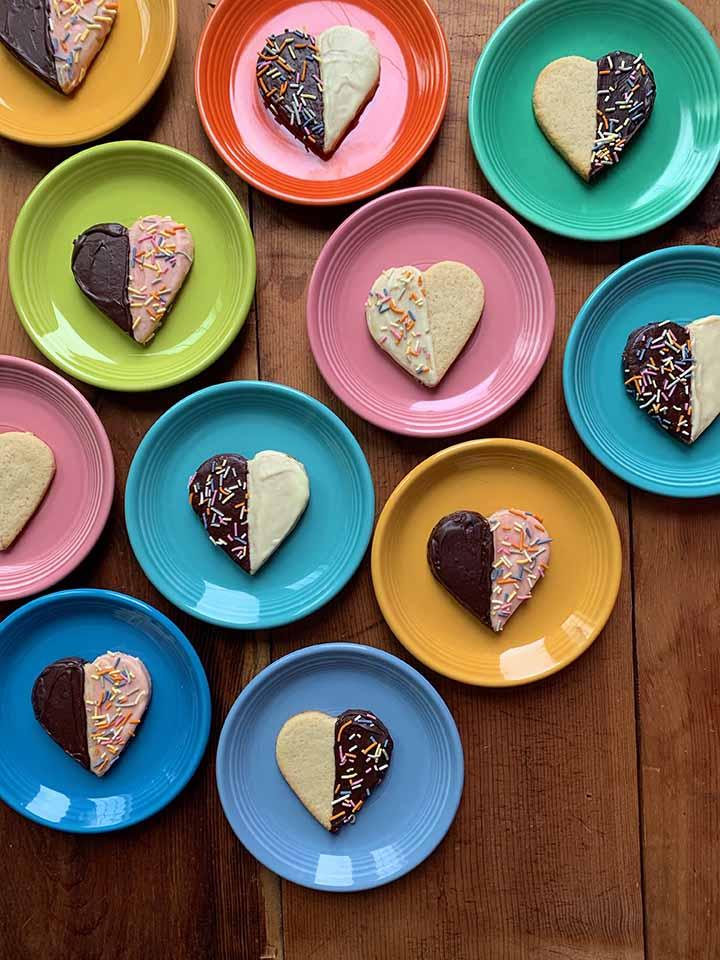 muliti-color plates holding gluten-free shortbread heart cookies