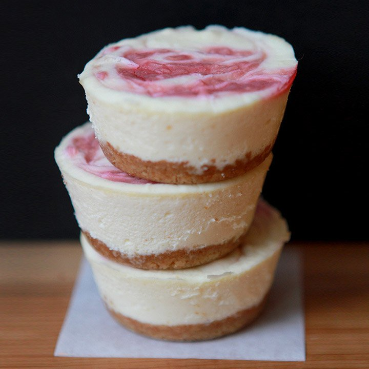 a stack of Keto Mini Cheesecakes against a black background