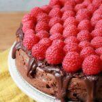 a Keto chocolate cheesecake topped with fresh raspberries