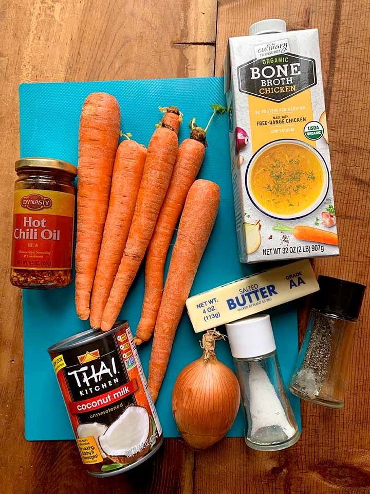 the ingredients for creamy carrot coconut soup