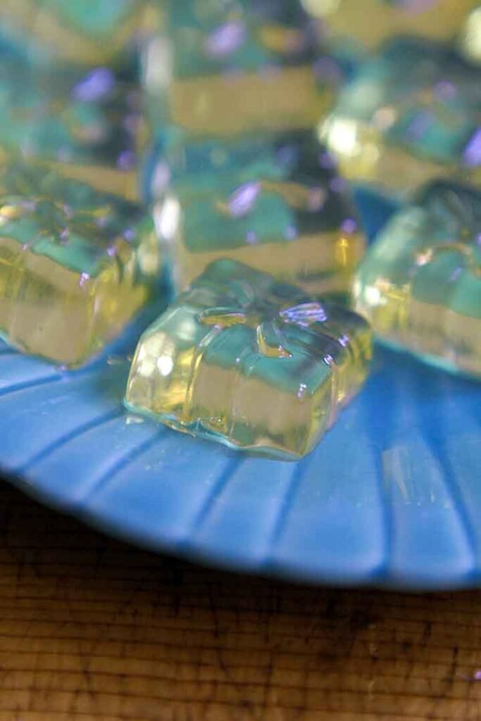 Apple Cider Vinegar Gummy gift shapes on a blue plate