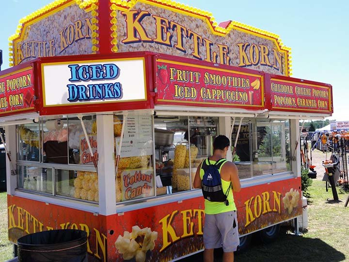 a stand for Kettle Korn at a fairgrounds