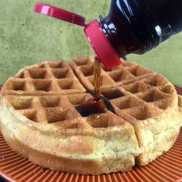 syrup pouring on Paleo waffle